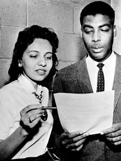 Diane Nash, left, Fisk junior and chairmen of the student protest group, and the Rev. Kelly Miller Smith, pastor of the First Baptist Church and president of the Nashville Christian Leadership council, confer before releasing a statement to reporters on their views of the sit-in demonstrations April 9, 1960. Gerald Holly / The Tennessean