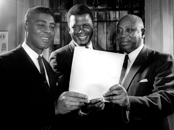 Black leaders explain to actor Sidney Poitier, center, plans for a fundraising drive to finance the Nashville Christian Leadership Council's work. The Rev. Kelly M. Smith, left, council president, and Dr. Matthew Walker Sr., campaign chairman, talk with the actor before he addresses a rally on March 4, 1962. Jack Corn / The Tennessean