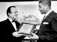 Ed Shea, left, executive vice-president of the Nashville Area Chamber of Commerce, presents the Rev. Kelly Miller Smith, pastor of the First Baptist Church, Capitol Hill, with a plaque commemorating the church's 100 years of community service Nov. 21, 1965. In the background is a sketch of the church's new building. Joe Rudis / The Tennessean