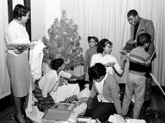 The Rev. Kelly Miller Smith, top right, helps his five children open their Christmas presents given by church members upon their return back home Dec. 30, 1963 from Cleveland, Ohio. Rev. Smith, one of Nashville leaders in the fight for integration, returns to First Baptist Church after leaving last fall for the historic Antioch Baptist Church in Cleveland. Dale Ernsberger / The Tennessean